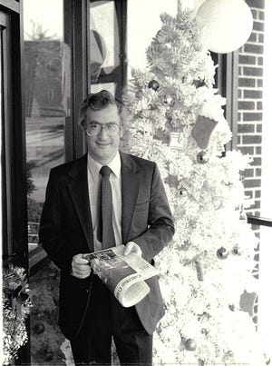 Current Argus Publisher Ned Cantwell beside the office Christmas Tree in December 1988.