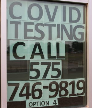 A sign at the Eddy County Public Health Office in Artesia reminds people to call for COVID-19 testing. The New Mexico Department of Health reported another death on Aug. 3, 2021.