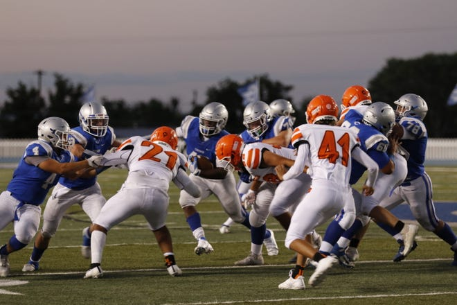 The second quarter of the 105th Eddy County War saw the Carlsbad Cavemen leading 16 to the Artesia Bulldog's 6 on Aug. 20 at Ralph Bowyer Stadium in Carlsbad, New Mexico.