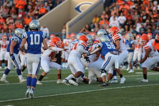 The Carlsbad Cavemen faced the Artesia Bulldogs Aug. 21 at Ralph Bowyer Stadium in the 105th Eddy County War.