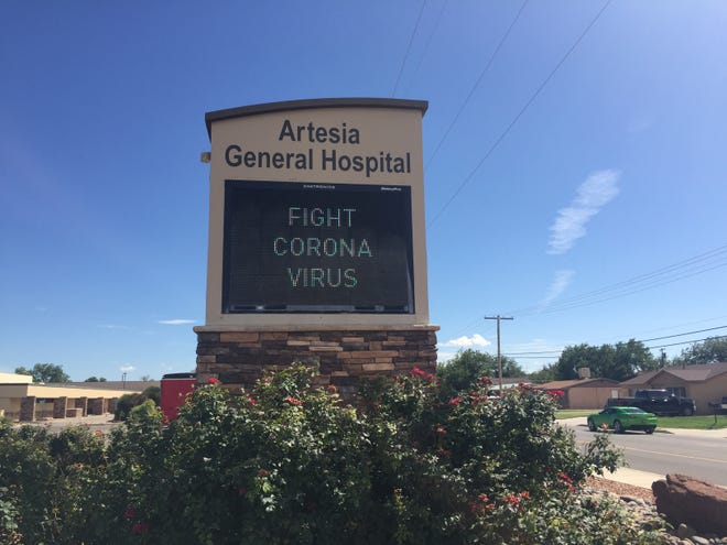 A sign at Artesia General Hospital reminds Eddy County residents to fight COVID-19. Two deaths were reported during the weekend of Aug. 23, 2021 in the County by New Mexico Department of Health.