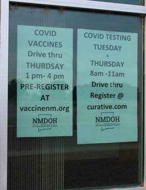 Signs at the Eddy County Public Health Office in Artesia indicate dates and times for COVID-19 vaccines and testing.
