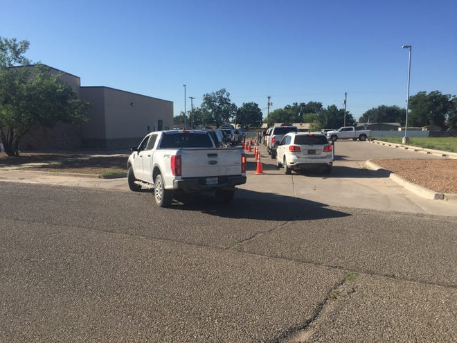Vehicles wait for COVID-19 tests and vaccinations Aug. 26, 2021 at the Eddy County Public Health Office in Artesia. New Mexico Department of Health said vaccination rates in Eddy County increased from early August.
