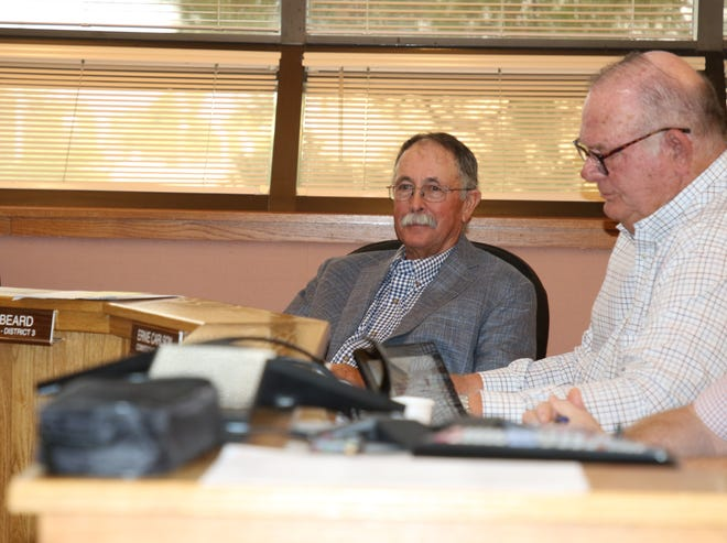 District 3 Eddy County Commissioner Fred Beard (left) and District 1 Eddy County Commissioner Ernie Carlson during the July 6, 2021 Eddy County Commission meeting. Commissioners passed a resolution declaring a local flooding disaster in Eddy County.