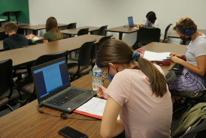 Students at Carlsbad Early College High School work during Grace Nwanne's fifth period class.