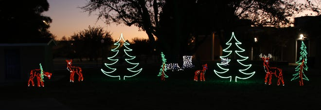 The first decorations for the annual Christmas on the Pecos event are put on display outside the Pecos River Village Conference Center in Carlsbad, NM on Nov. 14, 2020.
