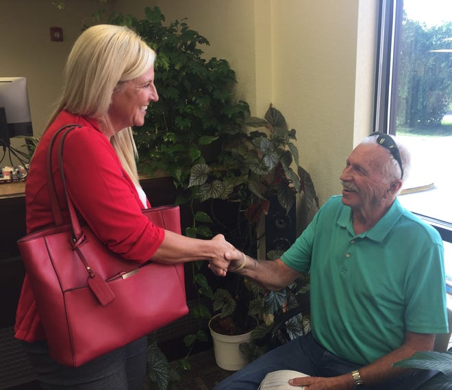 Carlsbad City Council Ward 3 candidates Karla Hamel and Dick Van Dyk shake hands at the Eddy County Clerk's office on Aug. 24, 2021.