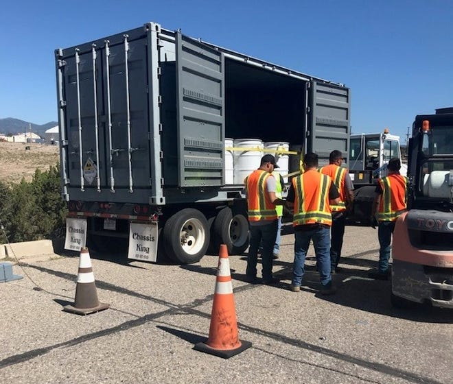 A crew with Newport News Nuclear BWXT-Los Alamos, the cleanup contractor for the EM Los Alamos Field Office (EM-LA), prepares EM-LA's 30th transuranic waste shipment of fiscal 2021 in Area G at Technical Area 54 for on-site loading at the Radioassay and Nondestructive Testing facility at Los Alamos National Laboratory.