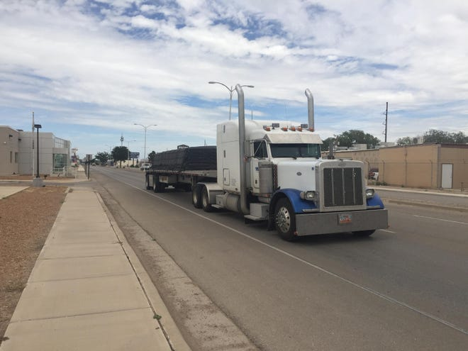 A semitrailer drives through Artesia on U.S. 285 on Aug. 12, 2021. According to a report from the Permian Strategic Partnership, safer roads and infrastructure were part of the group's plans for oil and gas communities in New Mexico and Texas.