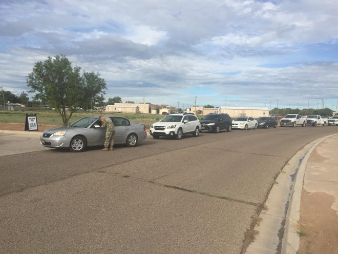 Vehicles wait in line at the Eddy County Public Health Office in Artesia on Sept. 2, 2021 for COVID-19 testing and vaccinations.