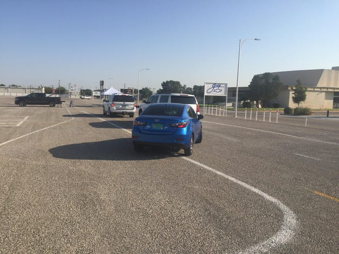 Cars line up for COVID-19 testing in Artesia on Sept. 14, 2021.