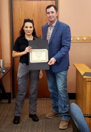 Eddy County Emergency Manager Jennifer Armendariz (left) receives a service award from Eddy County Board of County Commissioners Chairperson Steve McCutcheon on Sept. 21, 2021 in Carlsbad. Armendariz said Eddy County was looking to partner with the City of Carlsbad and Carlsbad Municipal Schools for increased COVID-19 testing.