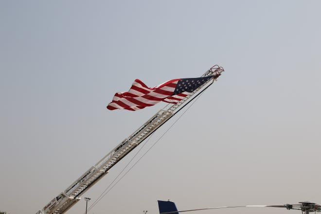 The American Flag waves in the breeze on Sept. 11, 2021 at the Walter Gerrells Civic Center in Carlsbad.