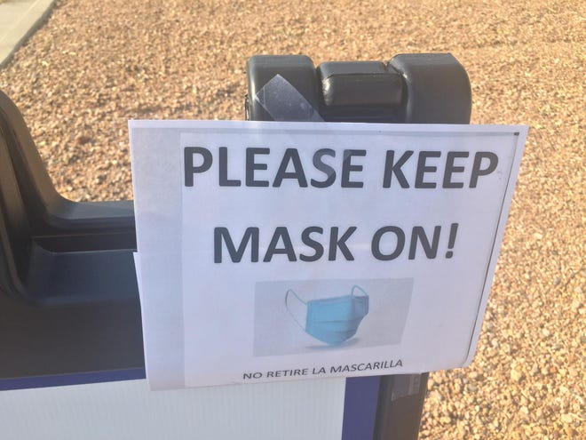 A sign at the Eddy County Public Health Office in Artesia reminds people to mask up for COVID-19 tests and vaccinations.