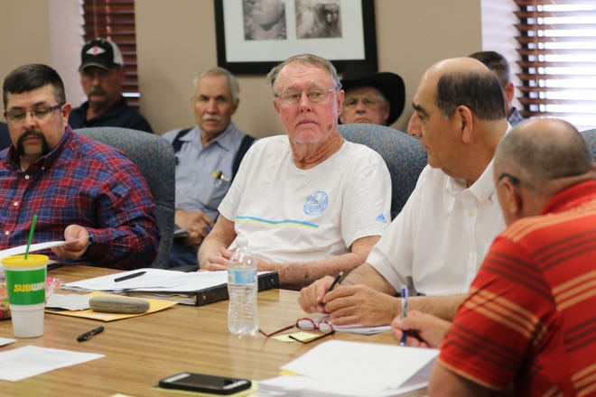 Members of the Carlsbad Irrigation District board hold a meeting, March 11, 2020 in Carlsbad.