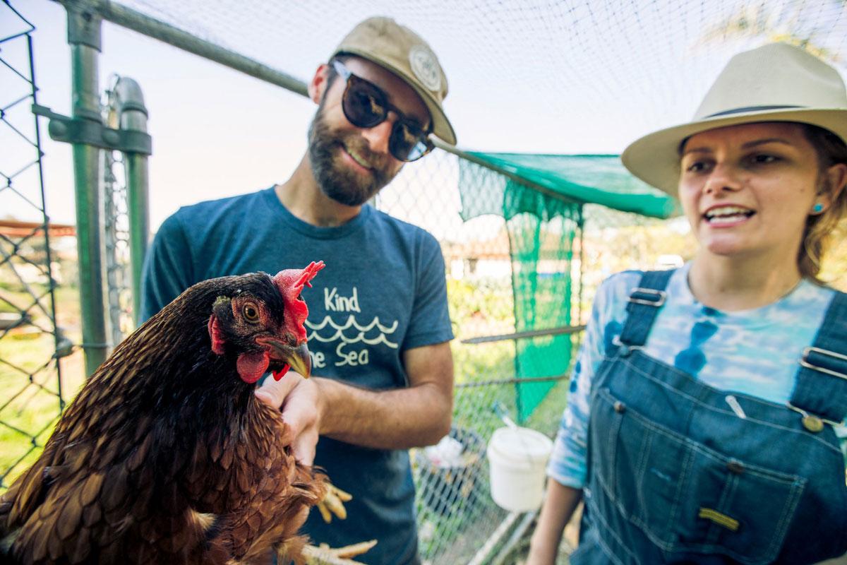 Brijette and her husband on the farm. Photo via Facebook/San Diego Seed Company